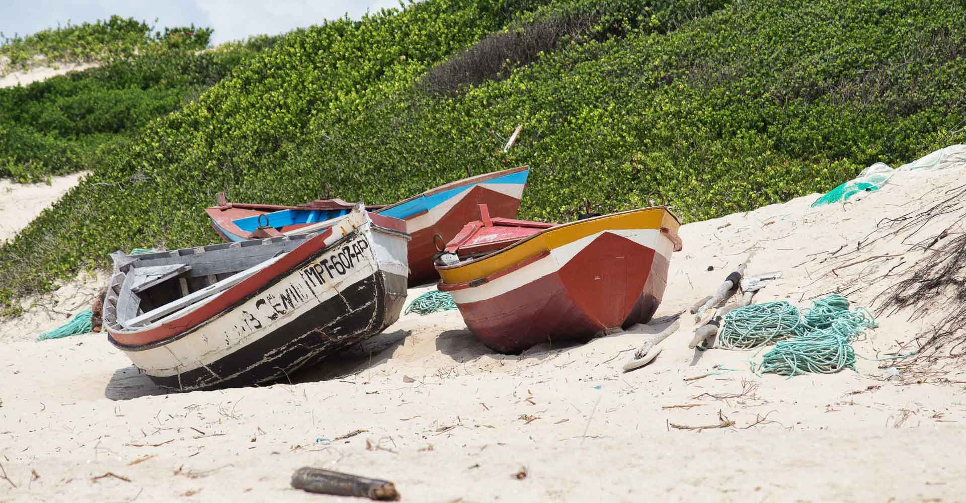 Traditional boats in Macaneta beach by mabeco tours from Maputo